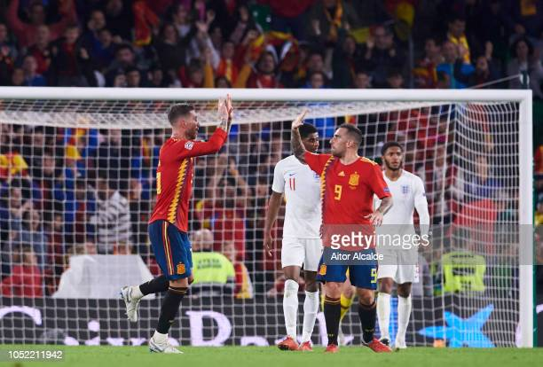 Sergio Ramos of Spain celebrates with his teammates Paco Alcacer of Spain after scoring his team's second goal during the UEFA Nations League A Group...