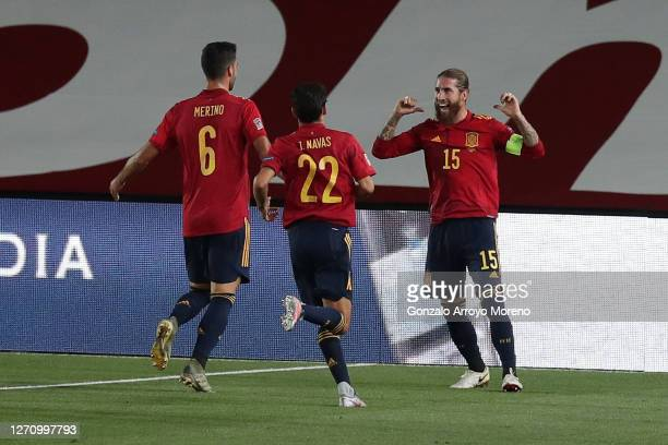 Sergio Ramos of Spain celebrates with teammates Mikel Merino and Jesus Navas after scoring his team's second goal during the UEFA Nations League...