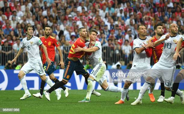 Sergio Ramos of Spain clashes with Ilya Kutepov of Russia during the 2018 FIFA World Cup Russia Round of 16 match between Spain and Russia at...