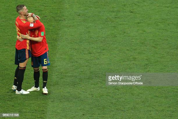 Sergio Ramos of Spain comforts a tearful Andres Iniesta of Spain after they are knocked out of the tournament on penalties during the 2018 FIFA World...