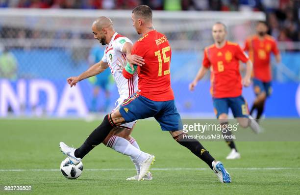 Sergio Ramos of Spain competes with Noureddine Amrabat of Morocco during the 2018 FIFA World Cup Russia group B match between Spain and Morocco at...