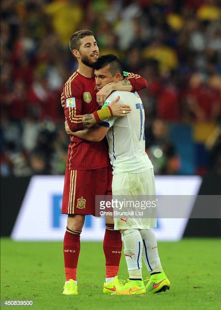 Sergio Ramos of Spain embraces Gary Medel of Chile at fulltime following the 2014 FIFA World Cup Brazil Group B match between Spain and Chile at...