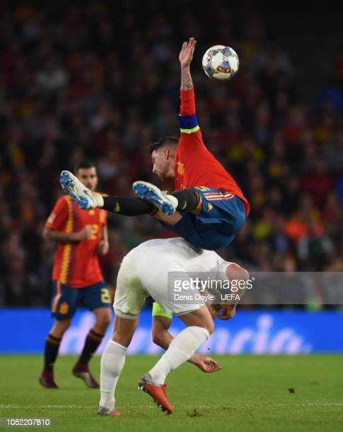 Sergio Ramos of Spain falls on top of Harry Kane of England during the UEFA Nations League A group four match between Spain and England at Estadio...