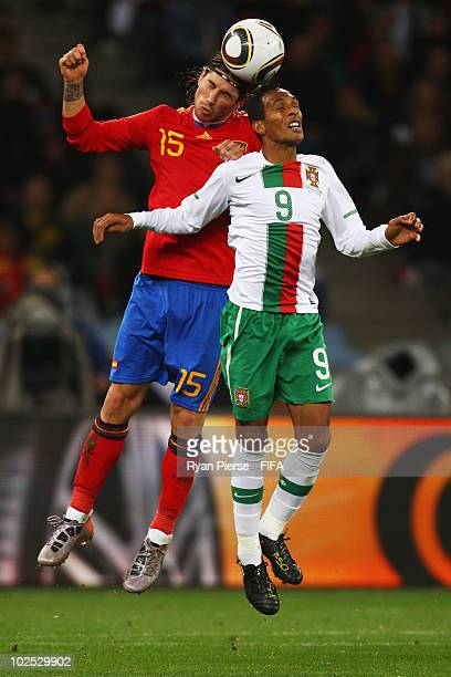 Sergio Ramos of Spain goes up for the ball with Liedson of Portugal during the 2010 FIFA World Cup South Africa Round of Sixteen match between Spain...
