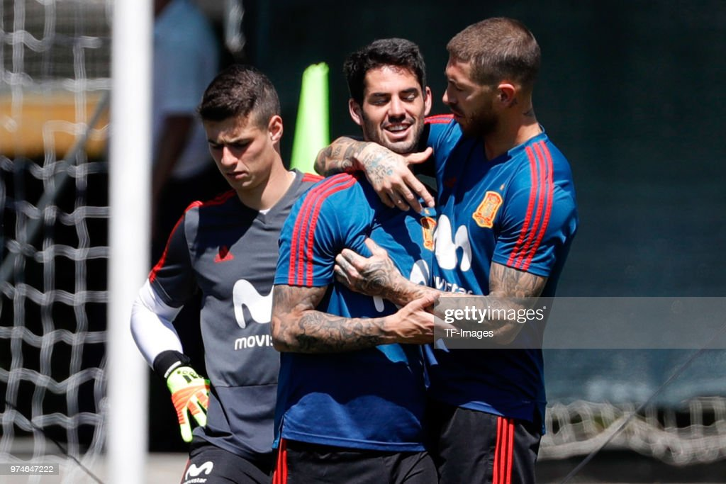 Sergio Ramos of Spain hugs Isco Alarcon of Spain during a training session on June 11, 2018 in Krasnodar, Russia.