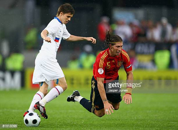 Sergio Ramos of Spain is tackled by Dmitri Torbinskiy of Russia during the UEFA EURO 2008 Group D match between Spain and Russia at Stadion Tivoli...