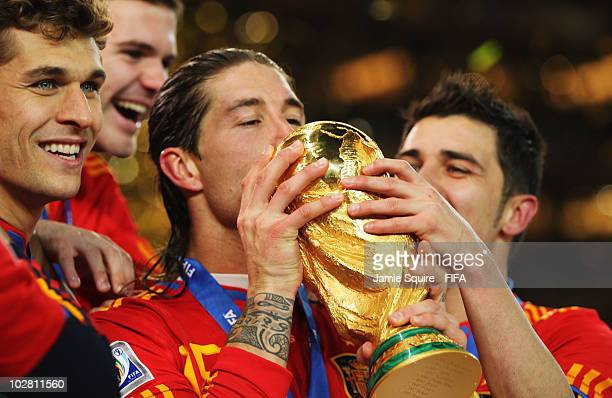 Sergio Ramos of Spain kisses the World Cup after the 2010 FIFA World Cup South Africa Final match between Netherlands and Spain at Soccer City...