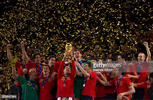 Sergio Ramos of Spain lifts the FIFA World Cup trophy after defeating the Netherlands 01
