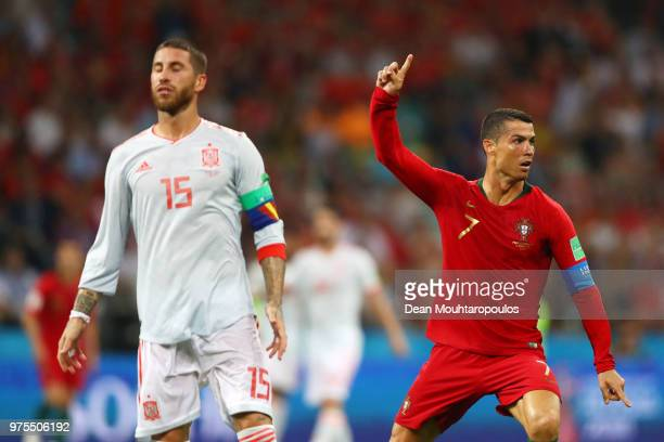 Sergio Ramos of Spain looks dejected as Cristiano Ronaldo of Portugal celebrates scoring his side's second goal during the 2018 FIFA World Cup Russia...