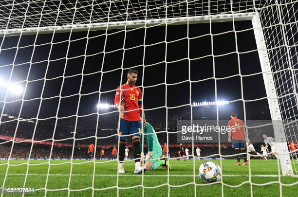 Sergio Ramos of Spain looks dejected as Raheem Sterling of England celebrates after scoring his team's third goal during the UEFA Nations League A...