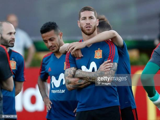 Sergio Ramos of Spain looks on and Jordi Alba of Spain hugs him during a training session on June 13 2018 in Krasnodar Russia