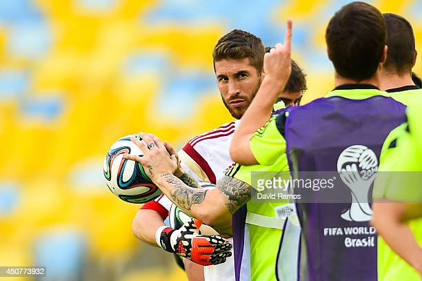 Sergio Ramos of Spain looks on during a Spain training session ahead of their 2014 FIFA World Cup Group B match against Chile at Maracana on June 17...