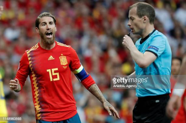 Sergio Ramos of Spain objects to the referee William Collum after a position during the UEFA European Qualifying Group F match between Spain and...