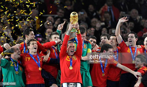 Sergio Ramos of Spain of Spain lifts the trophy and celebrates with teammates after the 2010 FIFA World Cup Final between the Netherlands and Spain...