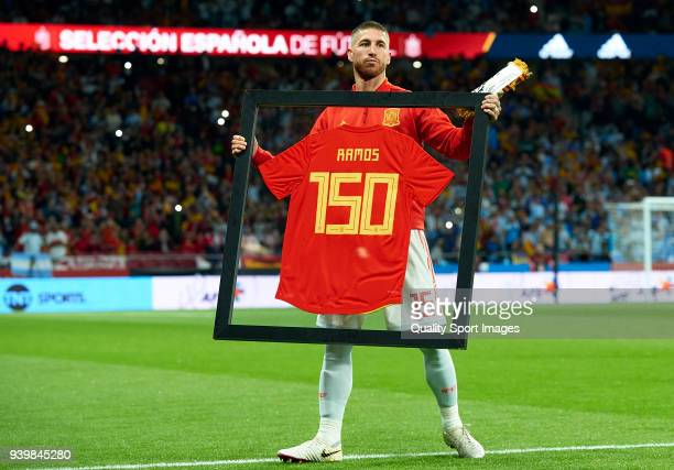Sergio Ramos of Spain poses with a special framed jersey marking his 150th cap for Spain prior to the international friendly match between Spain and...