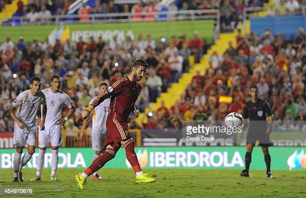 Sergio Ramos of Spain scores Spain's opening goal from the penalty spot during the UEFA EURO 2016 Group C Qualifier between Spain and FYR of...