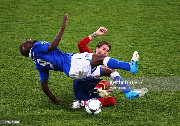 Sergio Ramos of Spain slides in to tackle Mario Balotelli of Italy during the UEFA EURO 2012 final match between Spain and Italy at the Olympic...