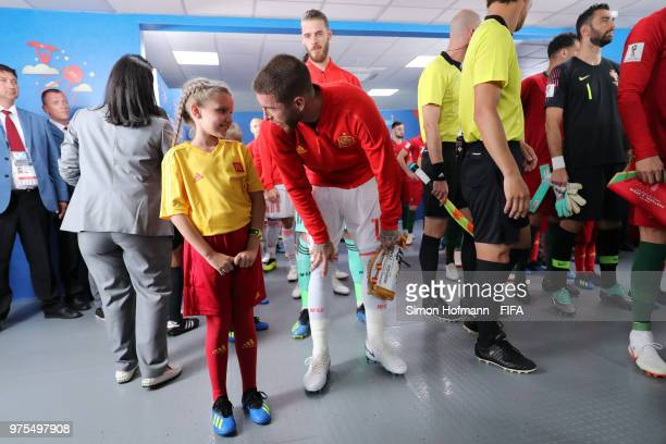Sergio Ramos of Spain speaks to a mascot during the 2018 FIFA World Cup Russia group B match between Portugal and Spain at Fisht Stadium on June 15...
