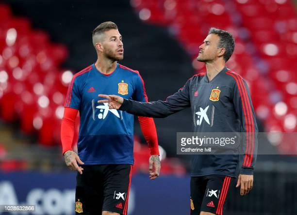 Sergio Ramos of Spain speaks to Luis Enrique Manager of Spain during the Spain Training Session at Wembley Arena on September 7 2018 in London England