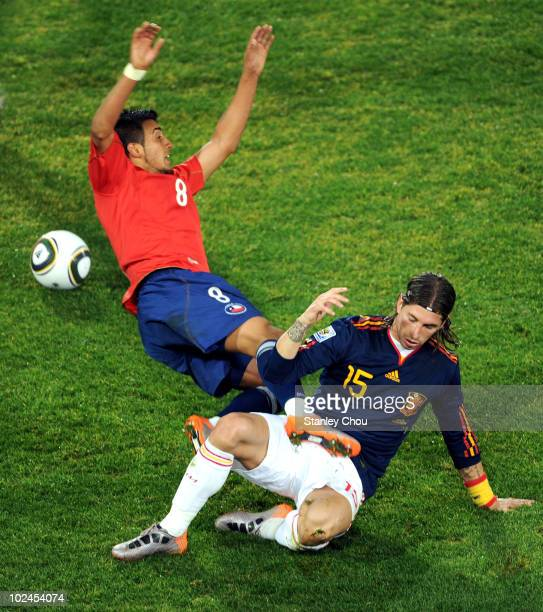 Sergio Ramos of Spain tackles Arturo Vidal of Chile during the 2010 FIFA World Cup South Africa Group H match between Chile and Spain at Loftus...
