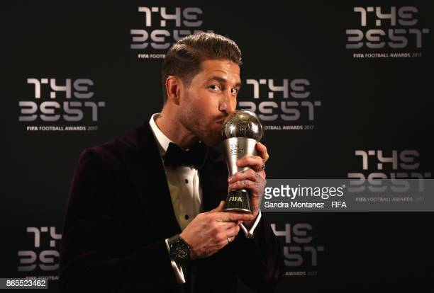 Sergio Ramos poses with hisFIFA FIFPro World 11 award after being included in the team of the year after The Best FIFA Football Awards at The London...