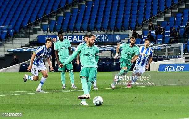 Sergio Ramos scores the first goal from the penalty spot during the Liga match between Real Sociedad and Real Madrid CF at Estadio Anoeta on June 21...