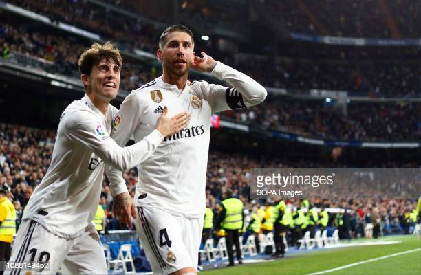 Sergio Ramos seen celebrating with Alvaro Odriozola after scoring a goal during the Copa del Rey Round of quarter-final first leg match between Real...