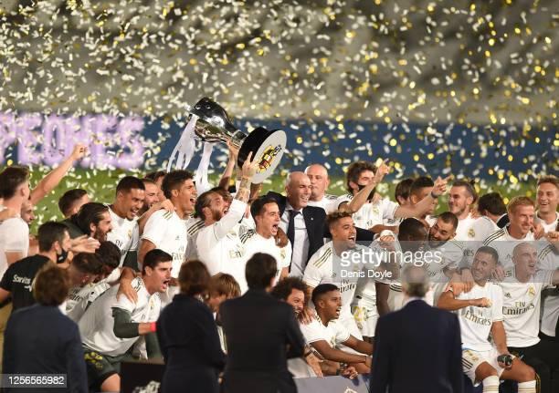 Sergio Ramos the Madrid captain lifts the La Liga trophy during the Liga match between Real Madrid CF and Villarreal CF at Estadio Alfredo Di Stefano...