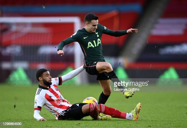 Sergio Reguilón of Tottenham Hotspur is tackled by Jayden Bogle of Sheffield United during the Premier League match between Sheffield United and...