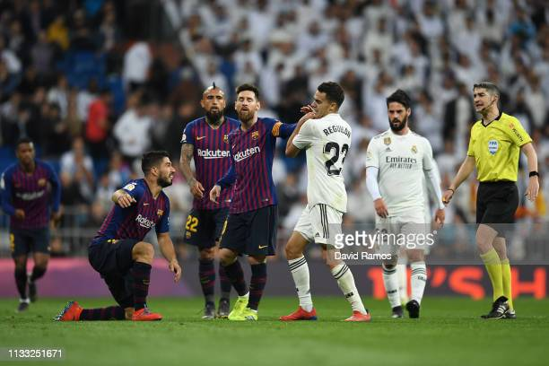 Sergio Reguilon of Real Madrid and Luis Suarez and Lionel Messi of Barcelona clash during the La Liga match between Real Madrid CF and FC Barcelona...