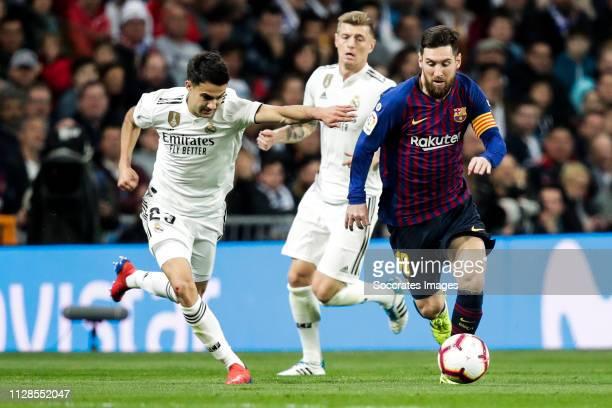 Sergio Reguilon of Real Madrid Lionel Messi of FC Barcelona during the La Liga Santander match between Real Madrid v FC Barcelona at the Santiago...
