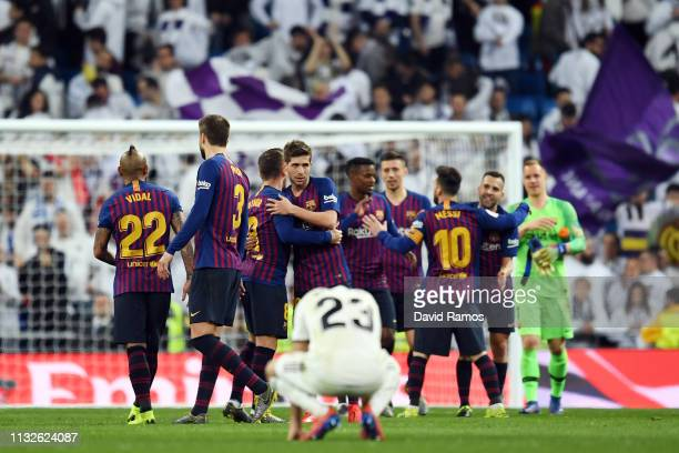 Sergio Reguilon of Real Madrid reacts as players of FC Barcelona celebrate after the Copa del Rey Semi Final second leg match between Real Madrid and...