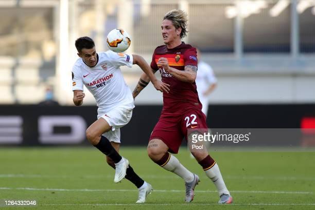 Sergio Reguilon of Sevilla and Nicolo Zaniolo of Roma battle for possession during the UEFA Europa League round of 16 single-leg match between...