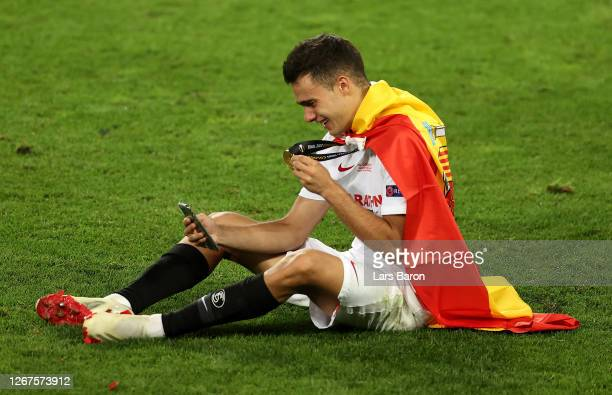 Sergio Reguilon of Sevilla celebrates with his winners medal on facetime following his team's victory in the UEFA Europa League Final between Seville...