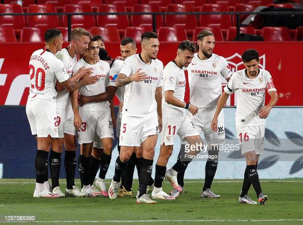 Sergio Reguilon of Sevilla FC celebrates with teammates after scoring his sides first goal during the Liga match between Sevilla FC and Valencia CF...