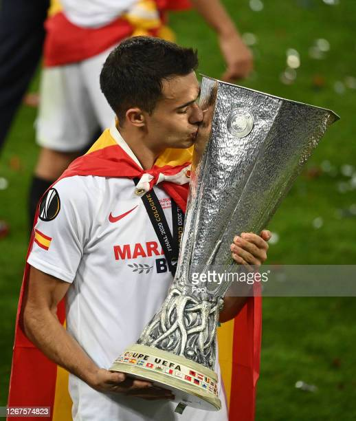 Sergio Reguilon of Sevilla FC kisses the UEFA Europa League Trophy in celebration following his team's victory in the UEFA Europa League Final...