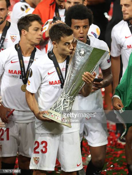 Sergio Reguilon of Sevilla kisses the UEFA Europa League Trophy following his team's victory in the UEFA Europa League Final between Seville and FC...