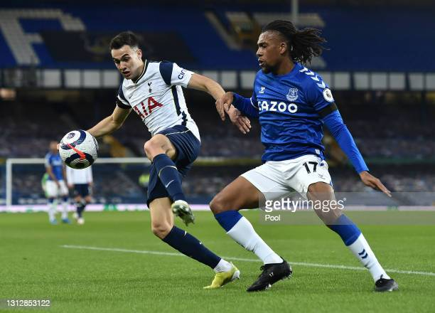 Sergio Reguilon of Tottenham Hotspur battles for possession with Alex Iwobi of Everton during the Premier League match between Everton and Tottenham...