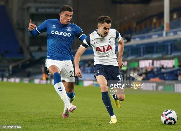 Sergio Reguilon of Tottenham Hotspur battles for possession with Ben Godfrey of Everton during the Premier League match between Everton and Tottenham...