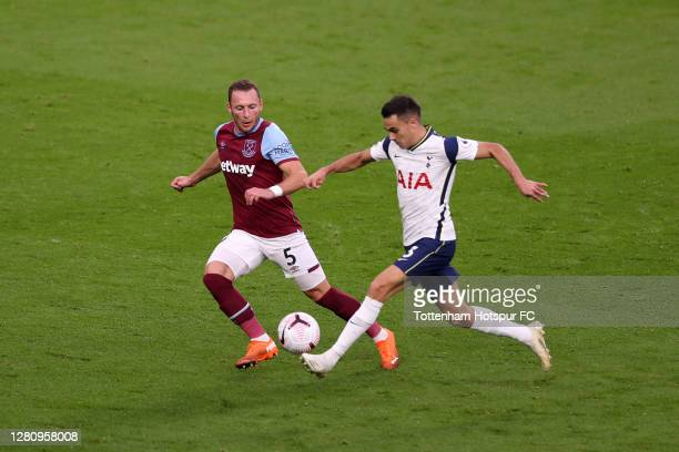 Sergio Reguilon of Tottenham Hotspur controls the ball as Vladimir Coufal of West Ham United looks on during the Premier League match between...