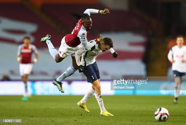 Sergio Reguilon of Tottenham Hotspur is challenged by Bertrand Traore of Aston Villa during the Premier League match between Aston Villa and...