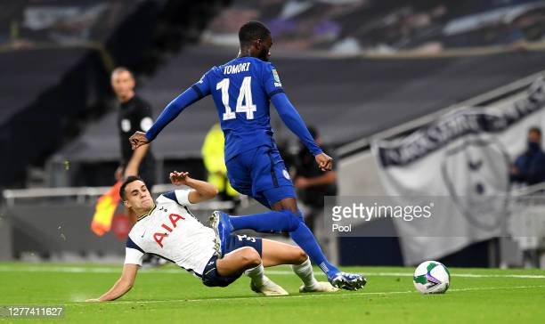Sergio Reguilon of Tottenham Hotspur is challenged by Fikayo Tomori of Chelsea during the Carabao Cup fourth round match between Tottenham Hotspur...