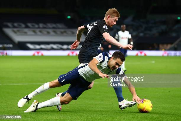 Sergio Reguilon of Tottenham Hotspur is challenged by Kevin De Bruyne of Manchester City during the Premier League match between Tottenham Hotspur...