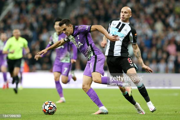 Sergio Reguilon of Tottenham Hotspur is fouled by Jonjo Shelvey of Newcastle United, which leads to a red card being shown during the Premier League...