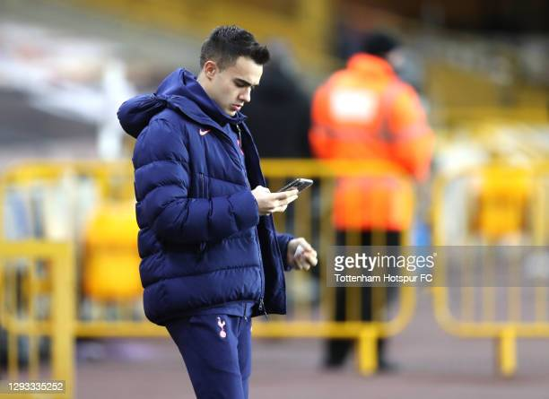 Sergio Reguilon of Tottenham Hotspur looks at his phone prior to the Premier League match between Wolverhampton Wanderers and Tottenham Hotspur at...