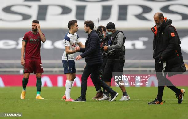 Sergio Reguilon of Tottenham Hotspur shakes hands with Ryan Mason, Interim Manager of Tottenham Hotspur following victory in the Premier League match...