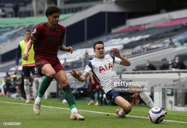 Sergio Reguilon of Tottenham Hotspur stretches to keep the ball in play whilst under pressure from Ki-Jana Hoever of Wolverhampton Wanderers during...
