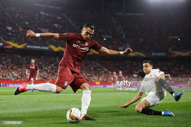 Sergio Reguilon Rodriguez of Sevilla FC competes for the ball with Ciprian Deac of CFR Cluj during the UEFA Europa League round of 32 second leg...