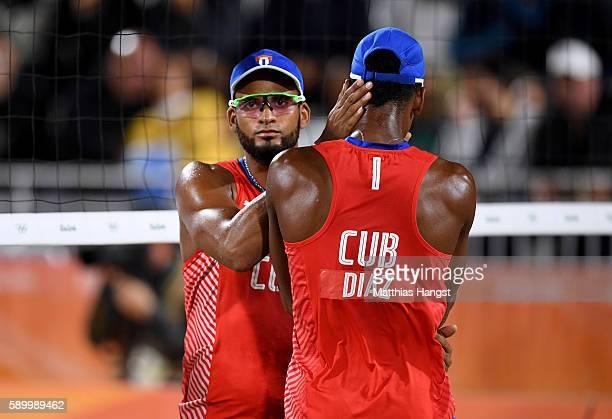 Sergio Reynaldo Gonzalez Bayard consoles Nivaldo Nadhir Diaz Gomez during the Men's Beach Volleyball Quarterfinal match between the Russia and Cuba...
