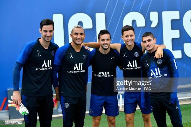 Sergio Rico, Keylor Navas, Pablo Sarabia, Ander Herrera and Marco Verratti pose as they arrive for a Paris Saint-Germain training session at Ooredoo...